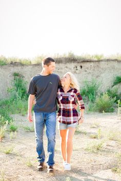 Outdoor, Country Styled Engagement Session with Their Puppy near Audubon, MN | Amber Langerud Photography | Couple giggling