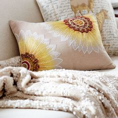Vibrant, strong and ruggedly beautiful, sunflowers seem to just make you smile. And our intricately beaded and stitched pillow, blooming with bold sunflowers, will bring smiles to your sofa.A neutral backdrop lets these artful beauties pop.