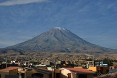 El Misti (Peru). 'The snow-covered, pointy-peaked volcano that presides over Arequipa, El Misti can give Japan's Mt Fuji a run for its money when it comes to perfect form. It was venerated by the Incas, who sacrificed humans at its summit.' http://www.lonelyplanet.com/peru/arequipa-and-canyon-country/arequipa/activities/hiking/el-misti