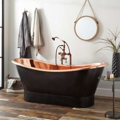 "Featuring a patina fused to the exterior of the tub, the 70"" Thaine Antique Black Copper Double Slipper Pedestal Tub is a showstopper. The polished copper interior peeking over the roll top rim just shimmers. The double slipper makes it enjoyable to recline from either side - beautiful and functional."