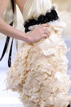feathered cocktail off-white dress with black belt.