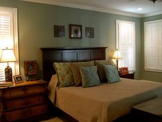 """Gorgeous wall color.  It's called """"Mystery Green"""".  I wonder if it would look as nice with our pine headboard as it does with this darker wood."""