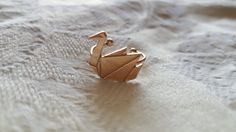 Beautiful gold origami crane ring :) Perfect gift for those with minimal, elegant style.