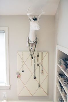 closet idea..have contractor save space between beams for custom jewelry organization flanking each window