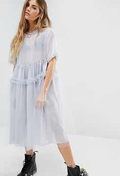 Thanks to London Fashion Week (now) regular Molly Goddard, your tulle and organza dreams are becoming a reality for autumn and beyond. This greyish lilac dress is ideal with chunky boots and an oversized biker