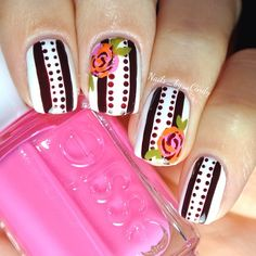 Cindy's Vanity Hand painted flowers. (Nails_by_Cindy) I can't keep my eyes off of this one!  I used essie's 'mod square,' 'blanc,' and 'bahama mama'.