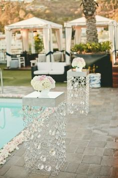 A rooftop wedding reception that is also poolside--sounds like a win/win situation! Photo: One Love Photography
