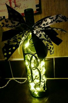 repurposed wine bottle with string lights and letter monogram lettering with ribbons...great gift ideas!
