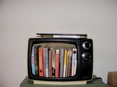 old tv = bookcase. another idea for your old tv, suz!