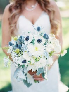 White bridal bouquet with pops of blue and yellow #thebridelink