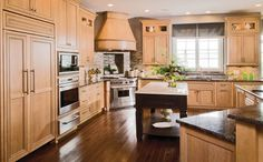 """You've heard the term """"editing being bantered about recently. Check out how big the pieces - the kitchen cabinetry - are seen in their full glory when small things calling out for attention are used minimally. #housetrends"""