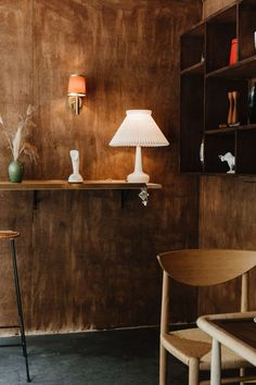 """Also pictured is a vintage Cobra Phone from Sweden and a green glazed mid-century Canadian studio pottery vase. The interior space is clad in birch plywood stained in Special Walnut from Old Masters Wood Stain in Iowa. """"We designed a sort of cafe diorama to create a playful fictional history for the Dark Horse brand, with its origins as a 1950-60s cafe, that holds a special place in the heart of Yorkville but is widely forgotten by the rest of the city."""""""