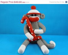 Sock Monkey Birthday Cake Topper Polymer Clay. $36.00, via Etsy.