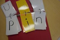 All of the consonants are placed on white index cards. Vowels are placed on yellow. The index cards can then be turned to make new words.
