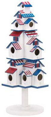 "Americana Birds Houses  Jaunty stars-and-stripes birds houses are a whimsical display of old-fashioned country style patriotism, and a ready-made village for a whole host of your favorite feathered friends!    Eight separate openings provide cozy shelter for a wide variety of birds; sturdy stand lets you place this darling decoration anywhere. Wood.    Birds Houses Dimension: 9 1/2"" x 8 1/2""; x 24 3/4"" high."