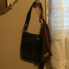 Coach purse Perfection. Has been used maybe 5 times, and has been stored in the cover bag to keep it nice and clean. It's black with white stitches. Cool leather and buckle details. Comes with the cover bag as well. Coach Bags Shoulder Bags