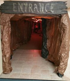 """Cave entrance, approximately 100ft. long, complete with a water feature. The kids had to go through it to get to the worship rally. Each day I added """"cave paintings"""" for them to look for."""