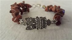Double Strand Gold Sandstone Chip Bracelet With A Center Silver Tone Owl Spacer...http://www.northerngems.ca/Goldstone-bracelet-p/ally.htm...$24.00