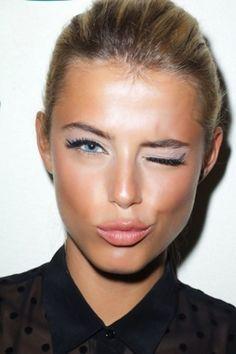 Gorgeous dewy bronzed skin and lavender eye shadow.