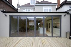 Rear extension with folding doors House Extension Design, Roof Extension, House Design, Extension Google, Extension Ideas, Glass Extension, Single Storey Extension, Glass Balcony, London House