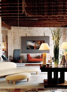 Everything in this living room is big and bold: the furniture, the art, and all framed by the brick walls and wood ceiling beams. Méchant Studio Blog: crush on tiles