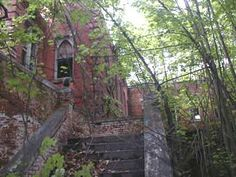 Asylum Stairs c. 12890  These buildings, constructed during a time when quality workmanship was the norm, are not sagging, decaying skeletons.  Though vandals and the elements have removed much of the wood and glass, from these structures, the brick work stands as a solid testimony to the workers who, in their day, built for the future and left behind a window into another century Hart Island, Asylum, Skeletons, Abandoned Places, Cry, Brick, Buildings, Stairs, Around The Worlds
