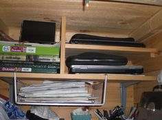 a close up shot of the laptop shelves, tucked into the far end of one of our bookshelves