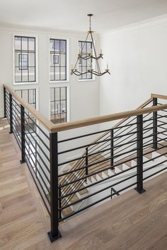 Home Bunch Interior Design Ideas Metal staircase Staircase metal railing The upstairs hallway wraps around the open staircase, making the whole house open and well connected The metal staircase railing is custom Metal Staircase Railing, Interior Stair Railing, Modern Stair Railing, Stair Railing Design, Wrought Iron Stairs, Home Stairs Design, Modern Stairs, Open Staircase, Indoor Stair Railing