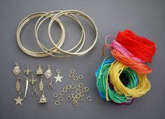 wrapped bangles DIY  You'll need:  a set of bangles  a variety of embroidery floss a variety of charms several 6mm and 7mm jump rings E6000 glue a toothpick 2 pairs of pliers scissors