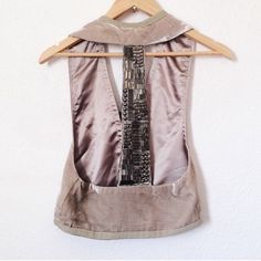 "Erin Wasson X RVCA  Sultan Vest This velvet vest features rhinestones and assorted metal beads at the T back. Grosgrain banding at open placket and at hem. Lined.  * 20"" long, measured from shoulder. * Fabrication: Silk velvet. * 82% silk/18% rayon. * Dry clean. * Made in the USA. RVCA Jackets & Coats Vests"