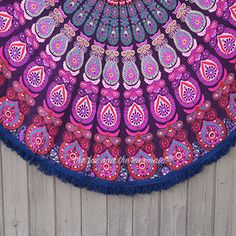 Hello Love! This beautiful, 72-inch pink and purple round mandala is big enough for two and is the perfect blanket for cuddling weather! It's no wonder it's one of our best sellers. It's has beautiful