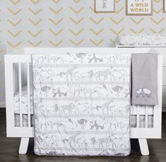 Decorating ideas for a monkey baby nursery design with decor suitable for a baby boy or girl in a neutral color scheme that includes ostrich, elephants, zebra, panda bears and giraffes.