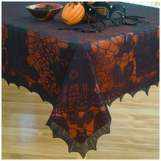 Lace Tablecloth with Orange Liner at Big Lots.