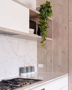 In all its intricate glory @caesarstoneau White Attica inspired by classic natural marbles sitting elegantly within this contemporary space @built_qa | Matched with @polytec Angora Oak Woodmatt and those impeccable herringbone floors. _____ #caesarstone #caesarstoneau #whiteattica