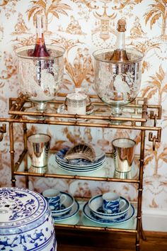 Today my house tour continues with some vignettes from the dining room. Many of you will recall that the Ralph Lauren gold leaf and cryst...