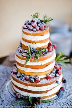 naked wedding cake with berries…
