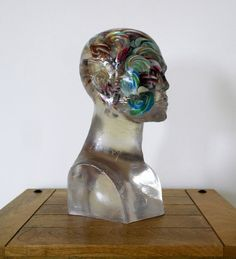 """""""Lollipop Brain"""" by Anthony Crammen. Sculpture, Subject: People and portraits, Photorealistic style, One of a kind artwork, Signed on the back, Size: 18 x 37 x 18 cm, Materials: Resin and Lollipops"""