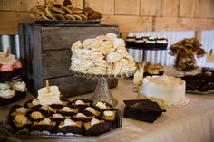 The reception featured a decadent dessert bar with cookies, cakes, and various pastries for wedding guests to indulge in. The sweets were perched on wooden crates and vintage trays to follow the bride and groom's rustic theme. Guests could chow down on desserts in between songs played by one of Pittsburgh's best wedding bands, Modern Times! http://www.moderntimesband.com/