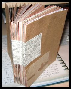 Mixed media journal made from brown bags, envelopes, and old book pages