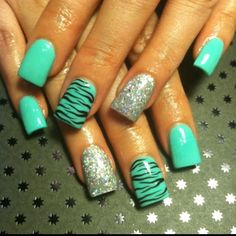 Awesome teal, zebra, and sparkle acrylic nails