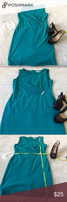 Calvin Klein Teal Dress Size 12 Beautiful Teal Calvin Klein Dress Size 12 Features gathering to accentuate your curves. This is brand new without tags. Dresses Midi