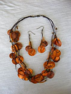 orange pearl buttons with glass beads necklace & earrings by pupinka, $40.00