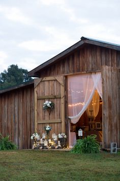 Rustic chic barn wedding reception decor idea - draped barn doors, candles + flowers {Frozen Exposure Photography + Videography}