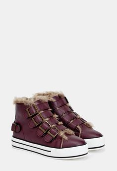 Kick your style up a notch with these chic and cool trainers, featuring a faux leather construction, faux fur lining and a velcro strap closure....