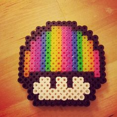 Rainbow Mushroom from Mario perler sprite.  A customization I did since I love rainbows.  can also be used for pride.