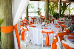 Reception set up with orange theme. Photo taken by Caterson Media caterson.com at Coconut Cove Resort in Islamorada, FL