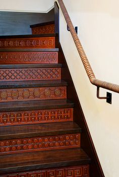 High Style | Mountain Living. Custom tooled leather panels for the stairs.