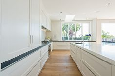 The client had originally chosen the fabulous band sawn blonded oak floor to give a casual atmosphere. To contrast with these floors, the kitchen consists of hand painted ply paneled doors to in keep with the casual appeal, natural stone splashback and benchtop. The island material, corian blends in with the colouring of the cabinetsRead more