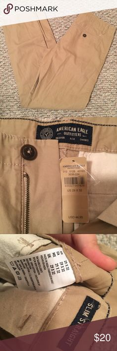 American Eagle Khakis NWT Slim Straight AEO Men's Khaiks. Size 29x32. Purchased as gift but never given. Smoke and pet free home. (No idea what happened to the last photo, I will retake when I get home tonight but I wanted to put it up so you can see that it has literally every tag still on it and have never been worn) :) American Eagle Outfitters Pants Chinos & Khakis