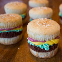 """Burger Cupcakes. Would be especially cute as """"crabby patties"""" for a sponge bob party"""